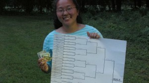 Monica with the prize money and bracket